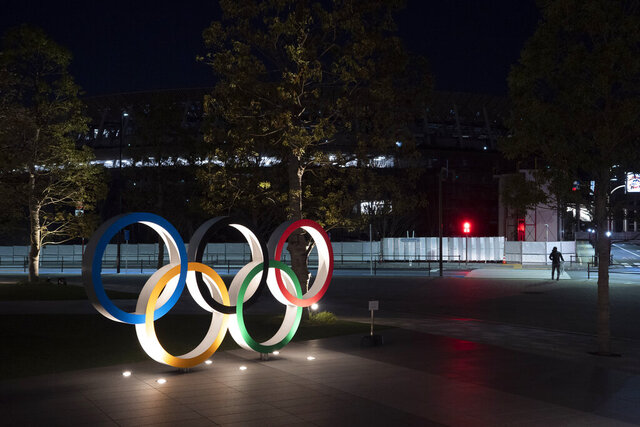 The Olympic rings stand near the New National Stadium in Tokyo, Tuesday, March 24, 2020. IOC President Thomas Bach has agreed