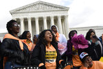 People protest outside the Supreme Court in Washington, Friday, Nov. 8, 2019. The Supreme Court on Tuesday takes up the Trump administration's plan to end legal protections that shield nearly 700,000 immigrants from deportation, in a case with strong political overtones amid the 2020 presidential election campaign. (AP Photo/Susan Walsh)