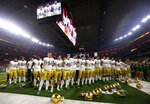 Notre Dame players stand in the end zone singing in the direction of their fans after their 30-3 loss to Clemson in the NCAA Cotton Bowl semi-final playoff football game, Saturday, Dec. 29, 2018, in Arlington, Texas. Clemson won 30-3. (AP Photo/Michael Ainsworth)