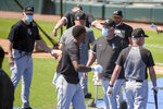 Chicago White Sox Manager Rick Renteria works his players during the first baseball practice of the restarted 2020 MLB season at Guaranteed Rate Field on Friday, July 3, 2020, in Chicago. (AP Photo/Mark Black)