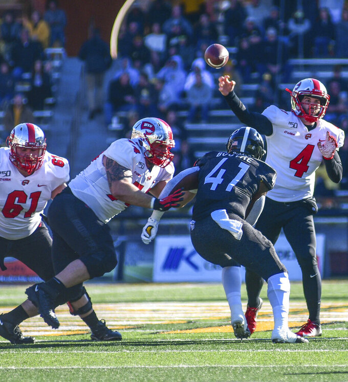Western Kentucky quarterback Ty Storey (4) makes a pass against Southern Mississippi during an NCAA college football game, Saturday, Nov. 23, 2019. (Cam Bonelli/Hattiesburg American via AP)