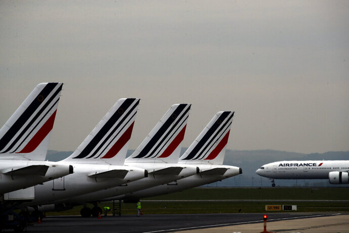 FILE - In this May 17, 2019 file photo, Air France planes are parked on the tarmac at Paris Charles de Gaulle airport, in Roissy, near Paris. The French government will implement an