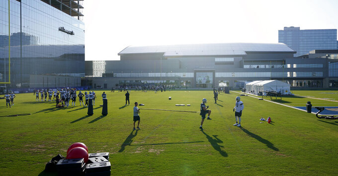 The Dallas Cowboys practice at NFL football training camp in Frisco, Texas, Friday, Aug. 14, 2020. (AP Photo/LM Otero)