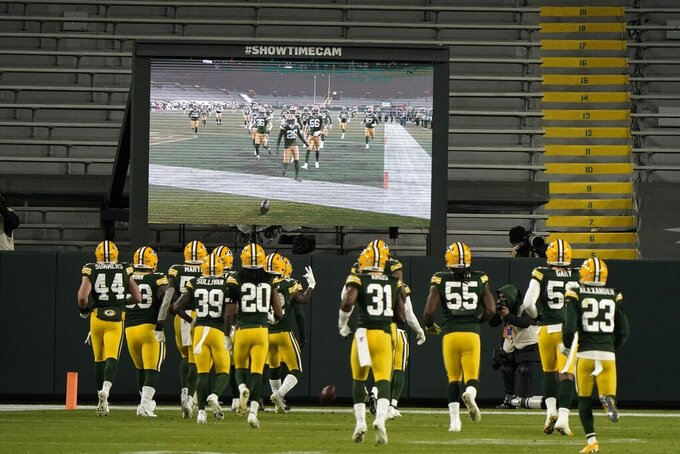 Green Bay Packers' Darnell Savage celebrates his interception with teammates during the second half of an NFL football game against the Chicago Bears Sunday, Nov. 29, 2020, in Green Bay, Wis. (AP Photo/Morry Gash)