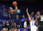 Vanderbilt's Joe Toye, left, shoots while defended by Kentucky's Jemarl Baker (13) during the first half of an NCAA college basketball game in Lexington, Ky., Saturday, Jan. 12, 2019. (AP Photo/James Crisp)