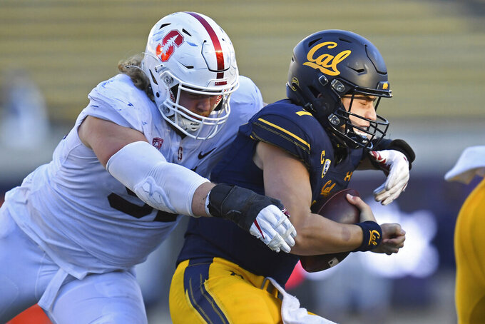 California quarterback Chase Garbers (7) is sacked by Stanford's Thomas Schaffer (91) during the third quarter of an NCAA college football game Friday, Nov. 27, 2020, in Berkeley, Calif. (Jose Carlos Fajardo/Bay Area News Group via AP)