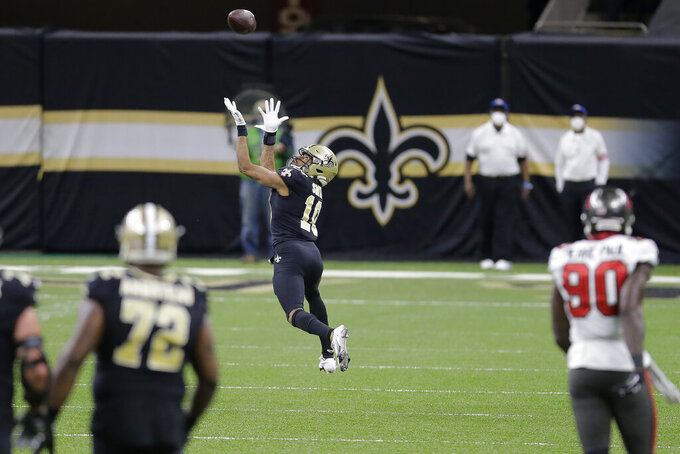 New Orleans Saints wide receiver Tre'Quan Smith (10) prepares to make a catch against the Tampa Bay Buccaneers during the first half of an NFL divisional round playoff football game, Sunday, Jan. 17, 2021, in New Orleans. Smith scored a touchdown on the play. (AP Photo/Brett Duke)