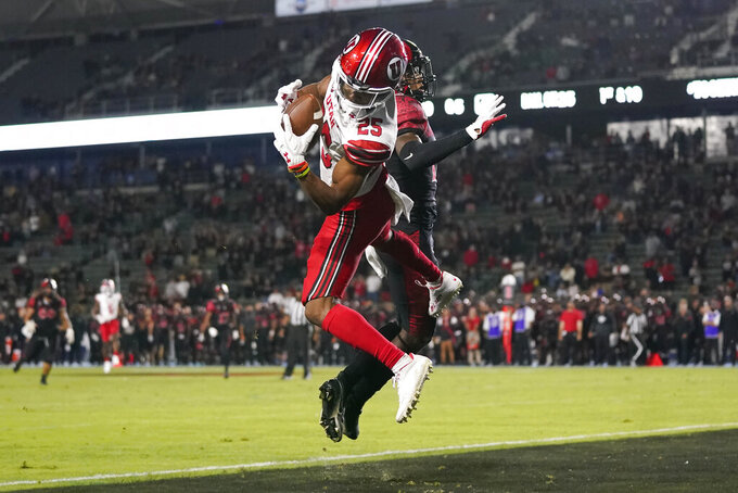 Utah wide receiver Jaylen Dixon (25) catches a pass in the end zone to score in overtime of an NCAA college football game Saturday, Sept. 18, 2021, in Carson, Calif. San Diego State cornerback Noah Tumblin (10) is at right. (AP Photo/Ashley Landis)