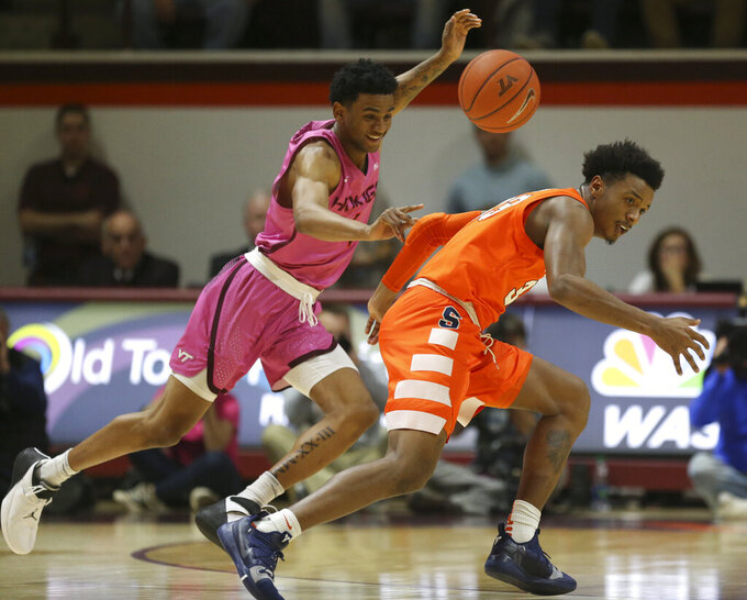Syracuse's Elijah Hughes. right, turns over the ball after it was tipped by Virginia Tech's Nickeil Alexander-Walker during an NCAA college basketball game in Blacksburg, Va., Saturday, Jan. 26,2019. (Matt Gentry/The Roanoke Times via AP)