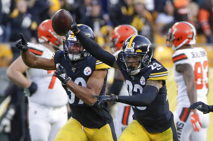 Pittsburgh Steelers cornerback Joe Haden (23),right, celebrates with free safety Minkah Fitzpatrick (39) after making an interception against the Cleveland Browns during the second half of an NFL football game, Sunday, Dec. 1, 2019, in Pittsburgh. (AP Photo/Gene J. Puskar)