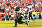 FILE - In this Sept. 22, 2019, file photo, Baltimore Ravens running back Mark Ingram II (21) spikes the ball after scoring a touchdown against the Kansas City Chiefs during the first half of an NFL football game, in Kansas City, Mo. Looking every bit as good as he did in his heyday with the New Orleans, Mark Ingram has proven to be a huge asset to the Baltimore Ravens' running game. (AP Photo/Ed Zurga, File)