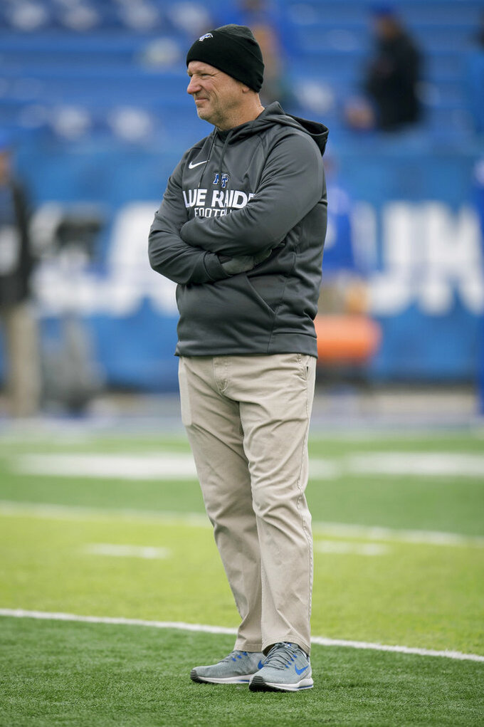 Middle Tennessee head coach Rick Stockstill watches pregame warm ups before an NCAA college football game against Kentucky in Lexington, Ky., Saturday, Nov. 17, 2018. (AP Photo/Bryan Woolston)