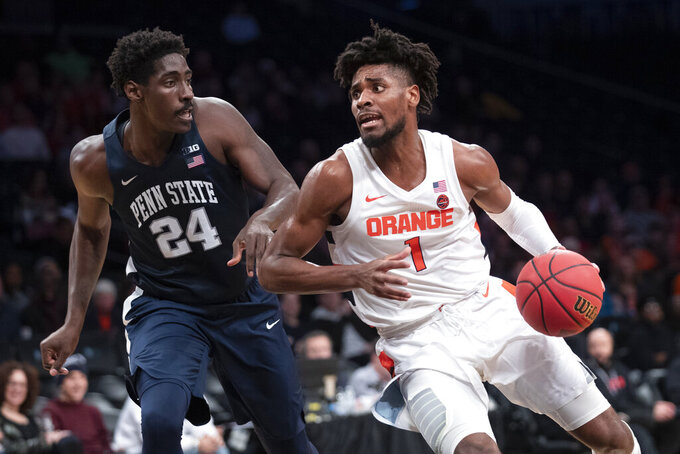 Syracuse forward Quincy Guerrier (1) drives against Penn State forward Mike Watkins (24) during the first half of an NCAA college basketball game in the consolation round of the NIT Season Tip-Off tournament, Friday, Nov. 29, 2019, in New York. (AP Photo/Mary Altaffer)