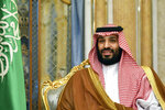 FILE - In this Sept. 18, 2019, file photo, Saudi Arabia's Crown Prince Mohammed bin Salman attends a meeting in Jeddah, Saudi Arabia. Cybersecurity experts said Thursday, Jan. 23, 2020, there are many questions still unanswered from an investigation commissioned by Bezos that said the billionaire's phone was hacked, apparently after receiving a video file with malicious spyware from the WhatsApp account of the crown prince.  (Mandel Ngan/Pool Photo via AP, File)