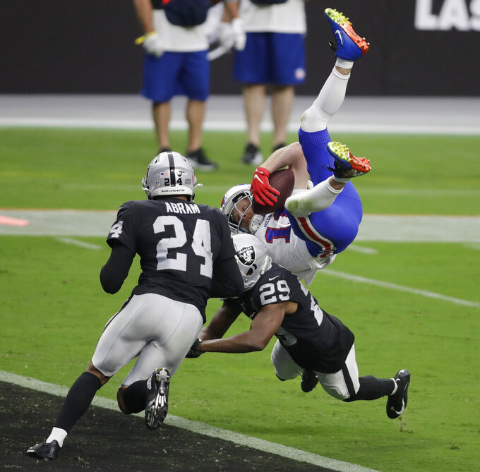 Buffalo Bills wide receiver Cole Beasley (11) catches a pass to score a touchdown over Las Vegas Raiders free safety Lamarcus Joyner (29) during the first half of an NFL football game, Sunday, Oct. 4, 2020, in Las Vegas. (AP Photo/Isaac Brekken)