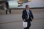 Environmental Protection Agency Administrator Andrew Wheeler walks from Air Force One at Andrews Air Force Base, Md., following a trip to Pittsburgh on Wednesday, Oct. 23, 2019. (AP Photo/Kevin Wolf)