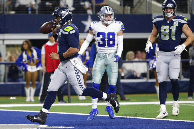 Seattle Seahawks quarterback Russell Wilson (3) runs into the end zone for a touchdown against the Dallas Cowboys Touchdown during the second half of the NFC wild-card NFL football game in Arlington, Texas, Saturday, Jan. 5, 2019. (AP Photo/Michael Ainsworth)