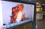 A TV screen shows a file image of a North Korea's missile launch during a news program at the Seoul Railway Station in Seoul, South Korea, Wednesday, Oct. 2, 2019. North Korea on Wednesday fired projectiles toward its eastern sea, South Korea's military said, in an apparent display of its expanding military capabilities ahead of planned nuclear negotiations with the United States this weekend. The sign reads: