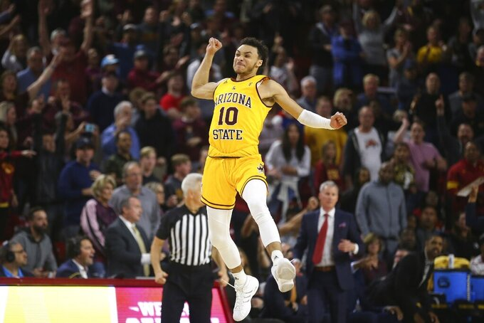 Arizona State guard Jaelen House (10) celebrates at the end of the team's 66-64 win over Southern California in an NCAA college basketball game Saturday, Feb. 8, 2020, in Tempe, Ariz. (AP Photo/Ross D. Franklin)