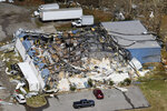 A destroyed business stands Tuesday, March 3, 2020, near Lebanon, Tenn. Tornadoes ripped across Tennessee early Tuesday, shredding more than 140 buildings and burying people in piles of rubble and wrecked basements. At least 22 people were killed. (AP Photo/Mark Humphrey)