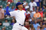 Chicago Cubs starting pitcher Adbert Alzolay throws to a Cincinnati Reds batter during the first inning of a baseball game, Tuesday, July 27, 2021, in Chicago. (AP Photo/David Banks)