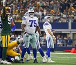 Dallas Cowboys' Cameron Fleming (75) and Brett Maher (2) watch Maher's missed field goal during the first half of the team's NFL football game against the Green Bay Packers in Arlington, Texas, Sunday, Oct. 6, 2019. (AP Photo/Ron Jenkins)