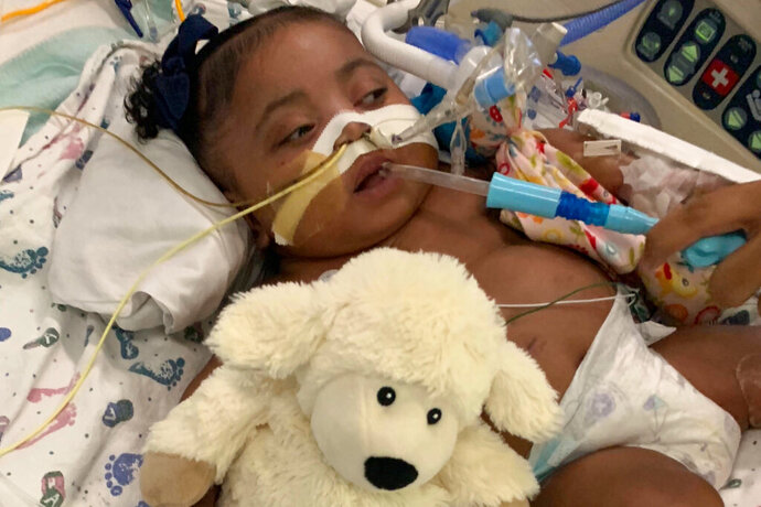 This Nov. 8, 2019 photo provided by Texas Right to Life shows Tinslee Lewis. A Texas appeals court on Friday, Jan. 3, 2020 agreed to delay a judge's ruling that would have allowed a hospital to end life-sustaining treatment for Tinslee Lewis, an 11-month-old girl who doctors say is in pain and will not get better. (Texas Right to Life via AP)