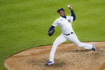 New York Yankees relief pitcher Aroldis Chapman throws in the seventh inning of the second baseball game of a doubleheader against the New York Mets, Friday, Aug. 28, 2020, in New York. (AP Photo/John Minchillo)