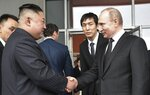 Russian President Vladimir Putin, right, and North Korea's leader Kim Jong Un shake hands after the talks in Vladivostok, Russia, Thursday, April 25, 2019. Russian President Vladimir Putin and North Korean leader Kim Jong Un said Thursday they had good talks about their joint efforts to resolve a standoff over Pyongyang's nuclear program, amid stalled negotiations with the United States. (Alexei Nikolsky, Sputnik, Kremlin Pool Photo via AP)