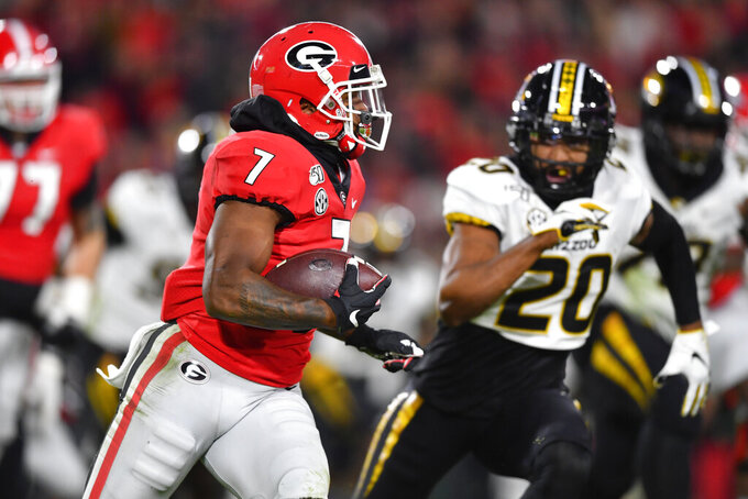 FILE - In this Nov. 9, 2019, file photo, Georgia running back D'Andre Swift runs as Missouri defensive back Khalil Oliver (20) defends during an NCAA college football game in Athens, Ga. Swift is one of the top running backs in the upcoming NFL draft. (AP Photo/John Amis, File)