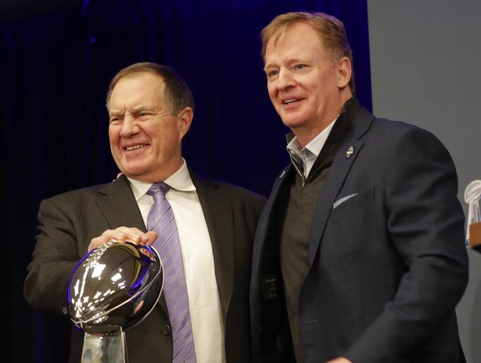 New England Patriots head coach Bill Belichick poses with NFL Commissioner Roger Goodell at a news conference for the NFL Super Bowl 53 football game Monday, Feb. 4, 2019, in Atlanta. The Patriots beat the Los Angeles Rams 13-3. (AP Photo/Morry Gash)