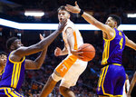 Tennessee guard Santiago Vescovi (25) passes the ball off to a teammate during an NCAA college basketball game against LSU at Thompson-Boling Arena, Saturday, Jan. 4, 2020,  Knoxville, Tenn. (Brianna Paciorka//Knoxville News Sentinel via AP)