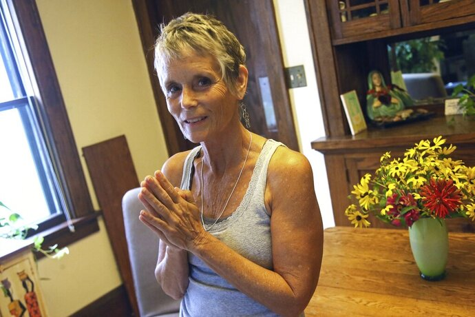 Marianne Turnbull poses Tuesday, September 10, 2019, in her St. Paul, Minn. home. She used to be a clinical social worker for the St. Paul Public Schools but had to retire in 2015 after she was diagnosed. She has stage IV ovarian cancer and will be among the people testifying Wednesday, September 11, before the Minnesota House Health and Human Services Policy Committee in a public hearing in support of the End-of-Life Option Act. (AP Photo/Jim Mone)