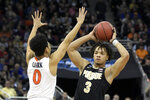 Purdue's Carsen Edwards (3) is defended by Virginia's Kihei Clark (0) during the first half of the men's NCAA Tournament college basketball South Regional final game, Saturday, March 30, 2019, in Louisville, Ky. (AP Photo/Timothy D. Easley)
