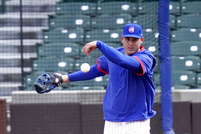 Chicago Cubs first baseman Anthony Rizzo throws during the team's last baseball workout Wednesday, March 31, 2021, before the home opener Thursday, April 1, 2021, against the Pittsburgh Pirates in Chicago. (AP Photo/Charles Rex Arbogast)