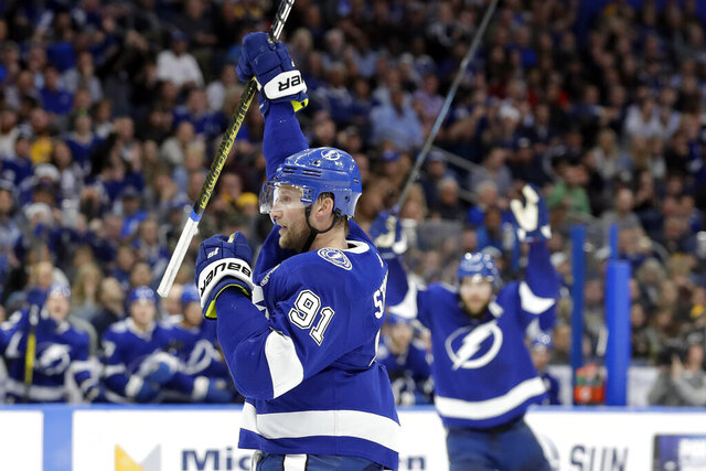 Tampa Bay Lightning center Steven Stamkos (91) celebrates his goal against the Boston Bruins during the second period of an NHL hockey game Thursday, Dec. 12, 2019, in Tampa, Fla. (AP Photo/Chris O'Meara)