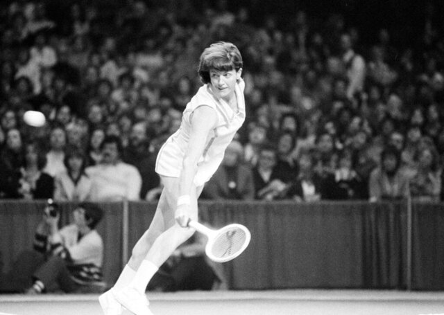 "FILE - In this Feb. 13, 1977, file photo, Margaret Court of Australia hits a backhand shot against Chris Evert of Fort Lauderdale, in the finals of the $100,000 Virginia Slims tennis tournament in Chicago. Tennis Australia said Saturday, Nov. 30, 2019, it plans to honor Margaret Court's 50th anniversary of her 1970 Grand Slam during January's Australian Open, but stressed her controversial anti-gay views ""do not align with our values of equality, diversity and inclusion.""(AP Photo/Larry Stoddard, File)"