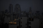 The capital city of Beirut remains in darkness during a power outage, Monday, July 6, 2020. The government in highly indebted Lebanon is in talks with the International Monetary Fund to secure financial assistance. But the talks have been bogged down by political divisions. Poverty and unemployment have been rising, only to be compounded by the economic restrictions imposed in effort to try to curb the spread of the coronavirus. (AP Photo/Hassan Ammar)