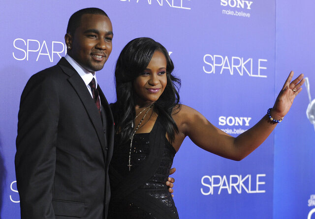 FILE - In this Aug. 16, 2012, file photo, Bobbi Kristina Brown, right, and Nick Gordon attend the Los Angeles premiere of