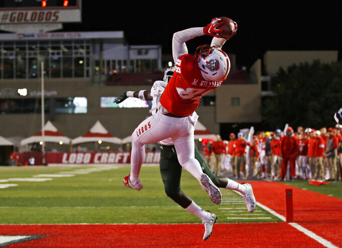 New Mexico tight end Marcus Williams (88) pulls in a touchdown catch against the defense of Colorado State cornerback Rashad Ajayi (4) during the first half of an NCAA college football game Friday, Oct. 11, 2019 in Albuquerque, N.M. (AP Photo/Andres Leighton)