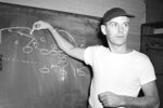 FILE- In this Sept. 26, 1947, file photo, Cleveland Browns coach Paul Brown diagrams one of his pass plays on the blackboard in Cleveland. Brown never saw color, and in 1946 he recruited Marion Motley and Bill Willis for his Cleveland team in the All-America Football Conference. (AP Photo/File)