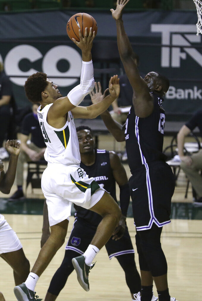 Baylor guard MaCio Teague (31) attempts a shot against Central Arkansas guard Eddy Kayouloud (13) in the first half of an NCAA college basketball game, Tuesday, Dec. 29, 2020, in Waco, Texas. (AP Photo/ Jerry Larson)