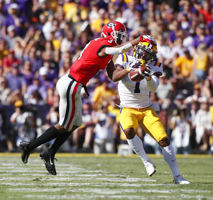 LSU wide receiver Ja'Marr Chase (1) makes a difficult catch against Georgia defensive back Tyson Campbell (3) during an NCAA college football game, Saturday, Oct. 13, 2018, in Baton Rouge, La. (Bob Andres/Atlanta Journal Constitution via AP)
