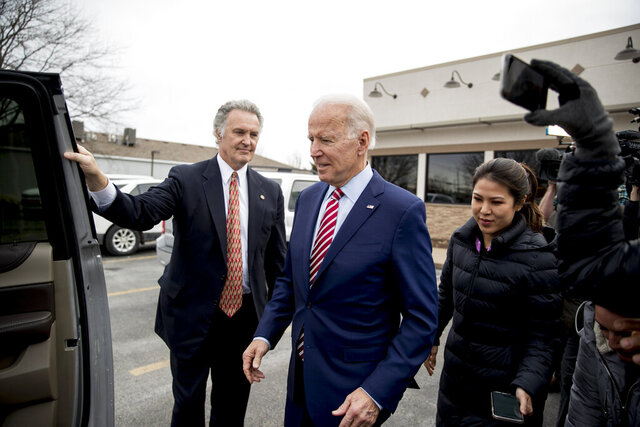 Democratic presidential candidate Joe Biden leaves after eating lunch at Ross' Restaurant, Monday, Jan. 6, 2020, in Bettendorf, Iowa. (AP Photo/Andrew Harnik)