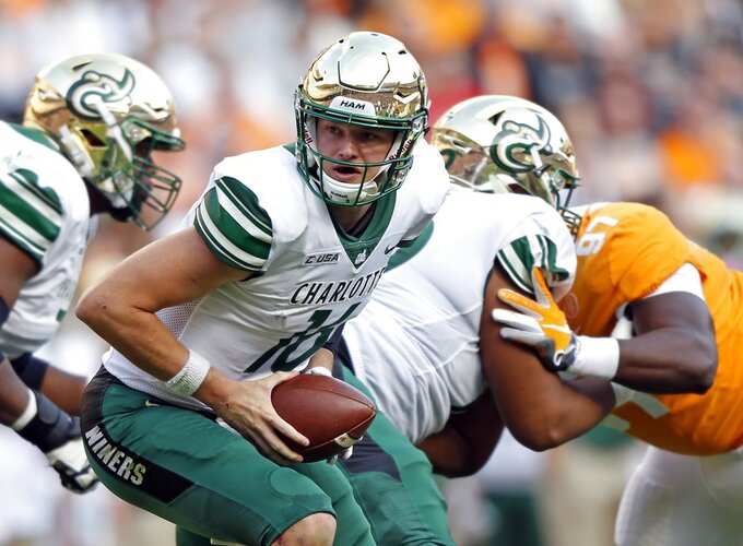 Charlotte quarterback Evan Shirreffs (16) turns to hand the ball off in the first half of an NCAA college football game against Tennessee Saturday, Nov. 3, 2018, in Knoxville, Tenn. (AP Photo/Wade Payne)