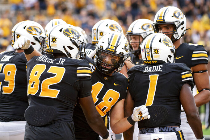 Missouri tight end Niko Hea, center, celebrates with teammates after scoring a touchdown during the fourth quarter of an NCAA college football game against Central Michigan, Saturday, Sept. 4, 2021, in Columbia, Mo. (AP Photo/L.G. Patterson)