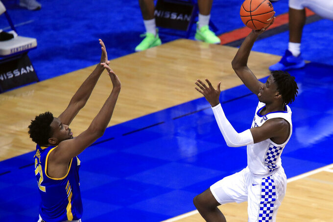 Kentucky's Terrence Clarke, right, shoots while defended by Morehead State's LJ Bryan during the first half of an NCAA college basketball game in Lexington, Ky., Wednesday, Nov. 25, 2020. (AP Photo/James Crisp)