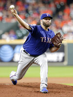 Texas Rangers starting pitcher Lance Lynn throws against the Houston Astros during the first inning of a baseball game Sunday, July 21, 2019, in Houston. (AP Photo/Michael Wyke)