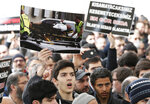 A demonstrator holding a picture from the scene of the mosque attacks in New Zealand, chant slogans during a protest against the attacks, in Istanbul, Friday, March 15, 2019. At least 49 people were killed in mass shootings at two mosques full of worshippers attending Friday prayers on what the prime minister called