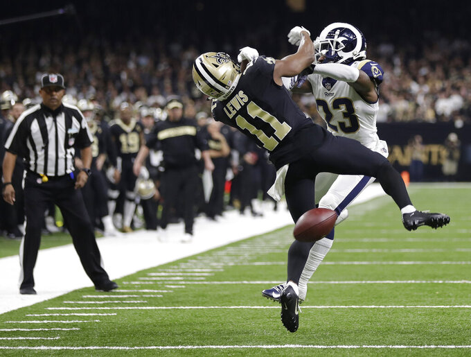 "FILE-In this Sunday, Jan. 20, 2019 file photo, New Orleans Saints wide receiver Tommylee Lewis (11) works for a catch against Los Angeles Rams defensive back Nickell Robey-Coleman (23) during the second half the NFL football NFC championship game, in New Orleans. The Rams won 26-23. New Orleans Saints fans have found some pretty creative ways to express their displeasure over the infamous ""no call"" during last weekend's Saints-Rams championship game. But their newest tactic may make the loudest statement - a Super Bowl boycott. (AP Photo/Gerald Herbert, File)"